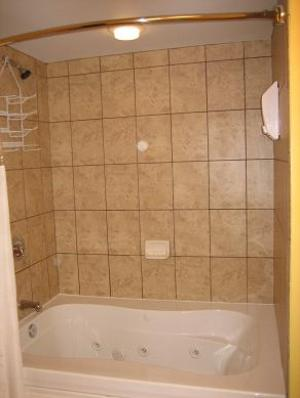 Relax in this comfortable jetted tub with a custom tile surround